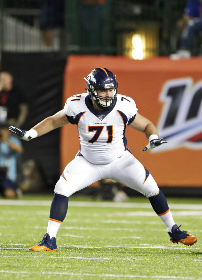 Denver Broncos offensive guard Austin Schlottmann gets set to block during the second half of the team's Pro Football Hall of Fame NFL preseason game against the Atlanta Falcons, Thursday, Aug. 1, 2019, in Canton, Ohio. (AP Photo/Ron Schwane)