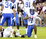 Kentucky safety Mike Edwards (7) reacts after tackling Texas A&M running back Trayveon Williams (5) during the first half of an NCAA college football game Saturday, Oct. 6, 2018, in College Station, Texas. (AP Photo/Michael Wyke)