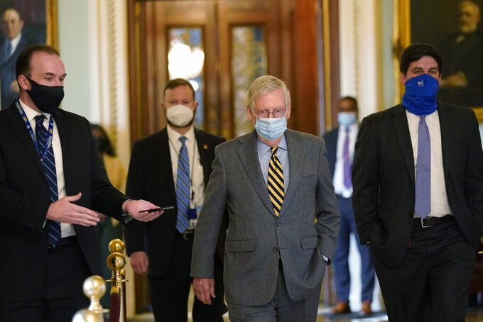 Senate Majority Leader Mitch McConnell of Ky., walks off of the Senate floor on Capitol Hill in Washington, Wednesday, Dec. 30, 2020. (AP Photo/Susan Walsh)