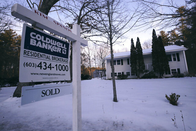 FILE - This Jan. 9, 2020, file photo shows a sold sign is posted on a real estate sign outside a home in Derry, N.H. On Tuesday, Jan. 28, 2020, the Standard & Poor's/Case-Shiller 20-city home price index for November is released. (AP Photo/Charles Krupa, File)