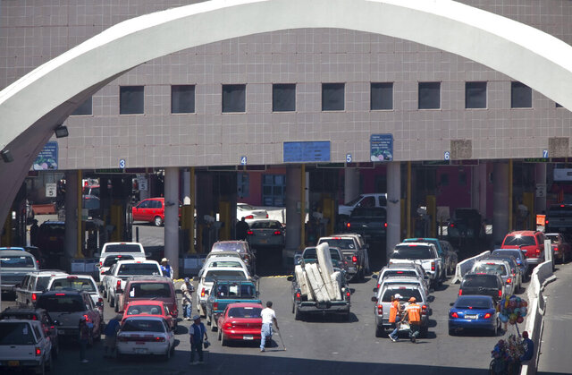 FILE - This June 1, 2009, file photo, shows vehicles waiting to enter the U.S. through The Dennis DeConcini Port of Entry in downtown Nogales, Ariz. For months, the U.S. has barred asylum seekers from approaching official crossings to file a claim. Now, some are rushing the ports by running through vehicle lanes to evade the process used to officially request asylum. That is causing massive delays at crossings in Arizona as U.S. Customs and Border Protection officials have barricaded lanes used by cars to legally enter the U.S. (Mark Henle/The Arizona Republic via AP, File)