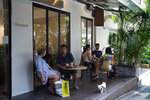 Customers sit in at tables outside the Found Cafe in Hong Kong on Sept. 13, 2020.Cannabis, also known as marijuana, in Hong Kong may be illegal, but the new Found Cafe is offering a range of food and drinks that contain parts of the cannabis plant without breaking any local laws. (AP Photo/Vincent Yu)