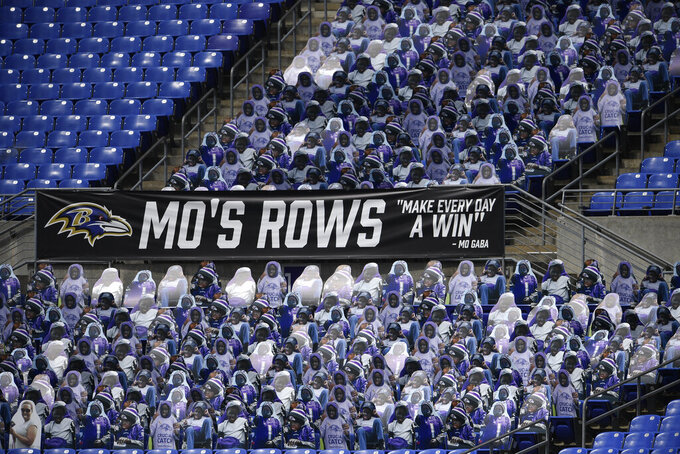 An entire section at the stadium is full of Mo Gaba cutouts during an NFL football game between the Baltimore Ravens and the Cleveland Browns, Sunday, Sept. 13, 2020, in Baltimore. Gaba was a fan of the Baltimore Ravens. (AP Photo/Nick Wass)