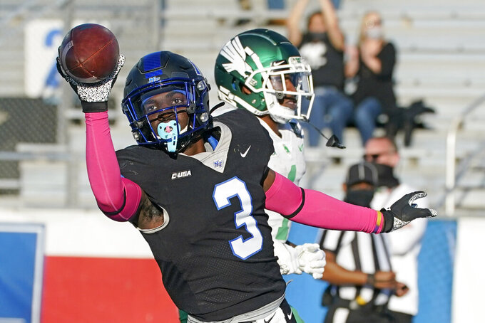 Middle Tennessee safety Gregory Grate Jr. (3) scores a touchdown after recovering a fumble recovery against North Texas in the first half of an NCAA college football game Saturday, Oct. 17, 2020, in Murfreesboro, Tenn. (AP Photo/Mark Humphrey)