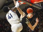 Villanova forward Saddiq Bey (41) dunks the ball over Army forward Ben Kinker (30) during the first half of an NCAA college basketball game Tuesday, Nov. 5, 2019, in Villanova, Pa. (AP Photo/Laurence Kesterson)
