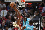 Miami Heat forward Chris Silva (30) is fouled by Charlotte Hornets forward Marvin Williams during the first half of an NBA basketball game, Monday, Nov. 25, 2019, in Miami. (AP Photo/Lynne Sladky)