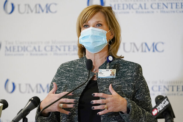 Dr. LouAnn Woodward, vice chancellor for health affairs and dean of the School of Medicine discusses how the growing COVID-19 transmission issue means ICU beds at the medical center and throughout the state are full or approaching capacity and how front-line caregiver resources are becoming more strained, during a news conference at the University of Mississippi Medical Center, Wednesday, Dec. 2, 2020, in Jackson, Miss. (AP Photo/Rogelio V. Solis)