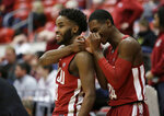 Washington State guard Ahmed Ali, left, and guard Viont'e Daniels celebrate during the second half of the team's NCAA college basketball game against Colorado in Pullman, Wash., Wednesday, Feb. 20, 2019. Washington State won 76-74. (AP Photo/Young Kwak)