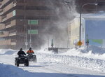 Two all-terrain vehicles cruise through downtown St. John's Newfoundland on Saturday, Jan.  18, 2020. The state of emergency ordered by the City of St. John's is still in place, leaving businesses closed and vehicles off the roads in the aftermath of the major winter storm that hit the Newfoundland and Labrador capital.  (Andrew Vaughan/The Canadian Press via AP)