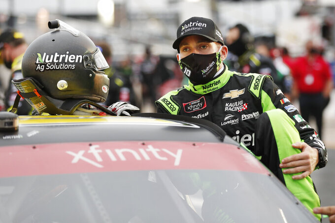 Ross Chastain gets into his car before a NASCAR Xfinity Series auto race at Charlotte Motor Speedway Monday, May 25, 2020, in Concord, N.C. (AP Photo/Gerry Broome)