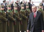Turkish President Recep Tayyip Erdogan inspects an Hungarian military honour guard, in Budapest, Hungary, Thursday, Nov. 7, 2019. Erdogan is on a one-day state visit to Hungary.( Presidential Press Service via AP, Pool )