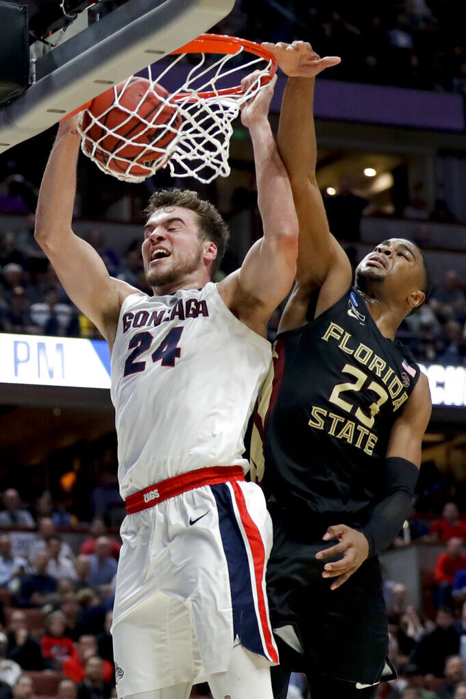 Gonzaga forward Corey Kispert, left, dunks past Florida State guard M.J. Walker during the second half an NCAA men's college basketball tournament West Region semifinal Thursday, March 28, 2019, in Anaheim, Calif. (AP Photo/Marcio Jose Sanchez)