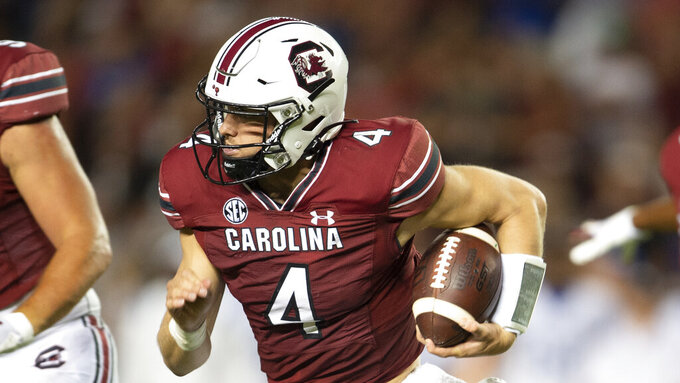 South Carolina quarterback Luke Doty (4) runs with the ball in the second half of an NCAA college football game against Kentucky, Saturday, Sept. 25, 2021 at Williams-Brice Stadium in Columbia, S.C. (AP Photo/Hakim Wright Sr.)