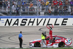 Kyle Larson celebrates after winning a NASCAR Cup Series auto race at Nashville Superspeedway Sunday, June 20, 2021, in Lebanon, Tenn. (AP Photo/Mark Humphrey)