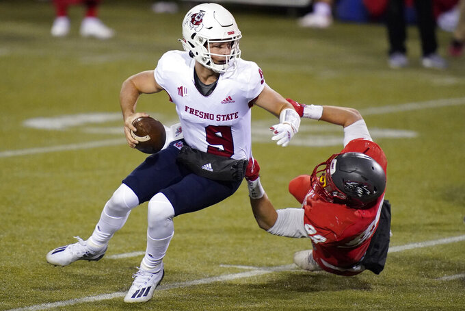 New Mexico defensive end Joey Noble (98) tackles Fresno State quarterback Jake Haener (9) during the second half of an NCAA college football game Saturday, Dec. 12, 2020, in Las Vegas. (AP Photo/John Locher)
