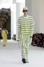 A model wears a creation as part of the Sunnei men's Spring-Summer 2020 collection, unveiled during the fashion week in Milan, Italy, Sunday, June 16, 2019. (AP Photo/Antonio Calanni)