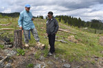 Former U.S. Forest Service Deputy Chief Jim Furnish talks with retired agency employee Dave Mertz at a logging site in the Black Hills National Forest, on July 14, 2021, near Custer City, S.D. Across the U.S. West, more trees have been dying as climate change dramatically alters the landscape and leaves forests more susceptible to wildfire and pests. (AP Photo/Matthew Brown)