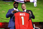 Louisiana State linebacker Devin White poses with NFL Commissioner Roger Goodell after the Tampa Bay Buccaneers selected White in the first round at the NFL football draft, Thursday, April 25, 2019, in Nashville, Tenn. (AP Photo/Mark Humphrey)