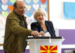 A couple cast their ballots for the presidential election at a polling station in Skopje, North Macedonia, Sunday, April 21, 2019. Polls were opened early on Sunday in North Macedonia for presidential elections seen as key test of the government following deep polarization after the country changed its name to end a decades-old dispute with neighboring Greece over the use of the term