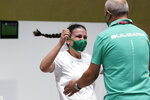 Silver medalist Antoaneta Kostadinova, of Bulgaria, runs to celebrate with her coach after the women's 10-meter air pistol at the Asaka Shooting Range in the 2020 Summer Olympics, Sunday, July 25, 2021, in Tokyo, Japan. (AP Photo/Alex Brandon)