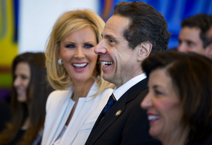 FILE- In this Jan. 1, 2015 file photo, New York Gov. Andrew Cuomo and his girlfriend Sandra Lee smile during an inaugural ceremony at One World Trade Center in New York. The couple have announced their break up after more than a decade together. Cuomo and Lee said in a statement Wednesday, Sept. 25, 2019, that their lives have gone in different directions but that they remain close friends. (AP Photo/Craig Ruttle, Pool, File)