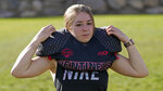 Sam Gordon puts on her shoulder pads, Oct. 20, 2020, in Herriman, Utah. Gordon was the only girl in a tackle football league when she started playing the game at age 9. Now, Gordon hopes she can give girls a chance to play on female-only high school teams through a lawsuit. (AP Photo/Rick Bowmer)