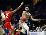 Houston's Galen Robinson Jr. (25) reaches for a loose ball as Ohio State's Musa Jallow (2) watches during the second half of a second round men's college basketball game in the NCAA Tournament Sunday, March 24, 2019, in Tulsa, Okla. Houston won 74-59. (AP Photo/Jeff Roberson)
