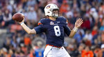 Auburn quarterback Jarrett Stidham (8) throws a touchdown pass against Liberty during the first half of an NCAA college football game, Saturday, Nov. 17, 2018, in Auburn, Ala. (AP Photo/Vasha Hunt)