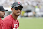 PGA golfer tiger Woods watches the first half of an NCAA college football game between Central Florida and Stanford, Saturday, Sept. 14, 2019, in Orlando, Fla. (AP Photo/John Raoux)