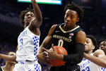 Vanderbilt's Saben Lee (0) pulls down a rebound between Kentucky's Tyrese Maxey (3) and EJ Montgomery (23) during the first half of an NCAA college basketball game in Lexington, Ky., Wednesday, Jan 29, 2020. (AP Photo/James Crisp)