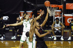 Oregon guard Chris Duarte (5) and Oregon guard LJ Figueroa (12) challenge the shot of Stanford forward Oscar da Silva (13) during the first half of an NCAA college basketball game Saturday, Jan. 2, 2021 in Eugene, Ore. (AP Photo/Andy Nelson)