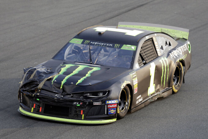 Kurt Busch (1) drives through Turn 2 during the NASCAR Cup Series auto race at Charlotte Motor Speedway in Concord, N.C., Sunday, Sept. 29, 2019. (AP Photo/Gerry Broome)