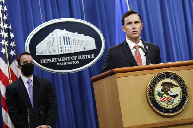 Acting Assistant Attorney General Brian Rabbitt, of the Justice Department's Criminal Division and other officials, speak, Thursday,  Oct. 22, 2020, at the Justice Department in Washington. A subsidiary of Goldman Sachs pleaded guilty on Thursday and agreed to pay more than $2 billion in a foreign corruption probe tied to the Malaysian 1MDB sovereign wealth fund, which was looted of billions of dollars in a corruption scandal.  The company, Goldman Sachs Malaysia, entered the plea in federal court in Brooklyn. (Yuri Gripas/The New York Times via AP, Pool)