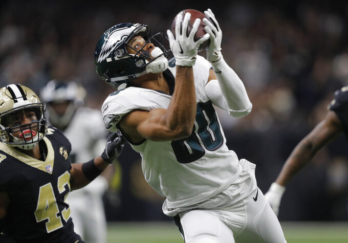 Philadelphia Eagles wide receiver Jordan Matthews (80) pulls in a touchdown reception in front of New Orleans Saints free safety Marcus Williams (43) in the first half of an NFL divisional playoff football game in New Orleans, Sunday, Jan. 13, 2019. (AP Photo/Gerald Herbert)