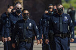 Los Angeles Police officers arrive to attend the memorial service for U.S. Marine Cpl. Hunter Lopez at the Palm Springs Convention Center in Palm Springs, Calif., Saturday, Sept. 18, 2021. Mourners in California said prayers and their final goodbyes Saturday to three Marines killed in last month's bombing in Afghanistan. Lopez was part of a special crisis response team sent to provide security and help U.S. State Department officials evacuate thousands of Americans and Afghan refugees fleeing the Taliban as the 20-year war drew to a close. (Terry Pierson/The Orange County Register via AP)