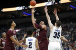 Missouri State's Gaige Prim (44) shoots over Indiana State's Jordan Barnes (2) and Jake LaRavia (35) during the second half of an NCAA college basketball game in the quarterfinal round of the Missouri Valley Conference men's tournament Friday, March 6, 2020, in St. Louis. (AP Photo/Jeff Roberson)