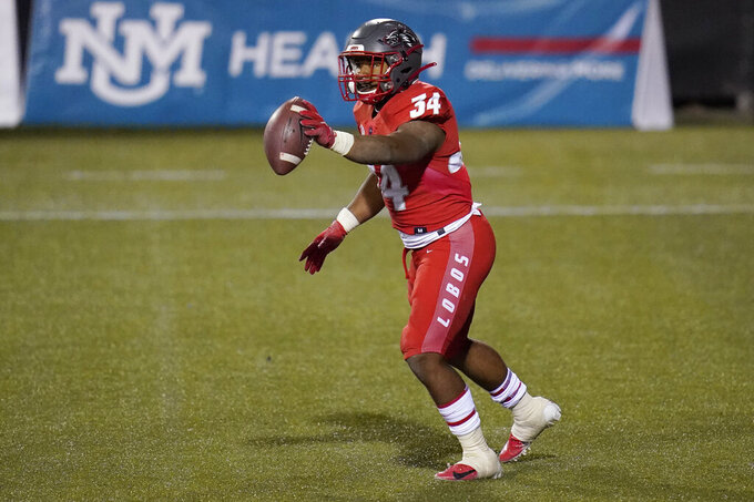 New Mexico running back Bobby Cole (34) celebrates after scoring a touchdown against Fresno State during the first half of an NCAA college football game Saturday, Dec. 12, 2020, in Las Vegas. (AP Photo/John Locher)