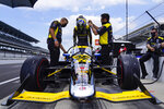 Zach Veach climbs into his car during practice for the Indianapolis 500 auto race at Indianapolis Motor Speedway in Indianapolis, Friday, Aug. 14, 2020. (AP Photo/Michael Conroy)