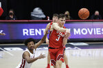 Utah guard Pelle Larsson passes the ball while pressured by Washington State guard Myles Warren during the second half of an NCAA college basketball game in Pullman, Wash., Thursday, Jan. 21, 2021. (AP Photo/Young Kwak)
