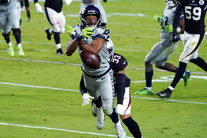 Seattle Seahawks wide receiver Tyler Lockett can't make the catch as Arizona Cardinals cornerback Byron Murphy (33) defends during the first half of an NFL football game, Sunday, Oct. 25, 2020, in Glendale, Ariz. (AP Photo/Rick Scuteri)