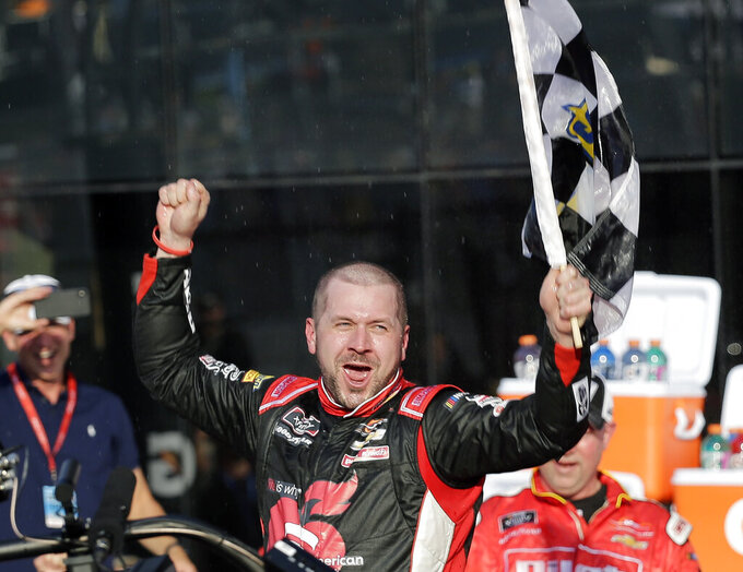 Michael Annett celebrates in Victory Lane after winning the NASCAR Xfinity series auto race at Daytona International Speedway, Saturday, Feb. 16, 2019, in Daytona Beach, Fla. (AP Photo/Terry Renna)