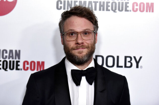 """FILE - Seth Rogen arrives at the 33rd American Cinematheque Award honoring Charlize Theron in Beverly Hills, Calif. on  Nov. 8, 2019. The actor, comedian, filmmaker and proud stoner has a deal with Crown for his first book. It's called """"Yearbook"""