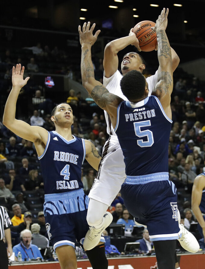 St. Bonaventure's Dominick Welch shoots over Rhode Island's Ryan Preston (5) and Tyrese Martin (4) during the first half of an NCAA college basketball game in semifinal round of the Atlantic 10 men's tournament Saturday, March 16, 2019, in New York. (AP Photo)