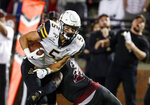 Appalachian State wide receiver Thomas Hennigan (5) catches a pass as Troy linebacker Carlton Martial (2) defends during the first half of an NCAA college football game Friday, Nov. 29, 2019, in Troy, Ala. (AP Photo/Butch Dill)