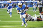 Los Angeles Chargers running back Austin Ekeler scores a touchdown past Cleveland Browns free safety John Johnson (43) during the second half of an NFL football game Sunday, Oct. 10, 2021, in Inglewood, Calif. (AP Photo/Kevork Djansezian)