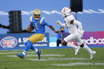 UCLA quarterback Dorian Thompson-Robinson (1) runs away from Stanford free safety Malik Antoine (3) during the first half of an NCAA college football game Saturday, Dec. 19, 2020, in Pasadena, Calif. (AP Photo/Ringo H.W. Chiu)
