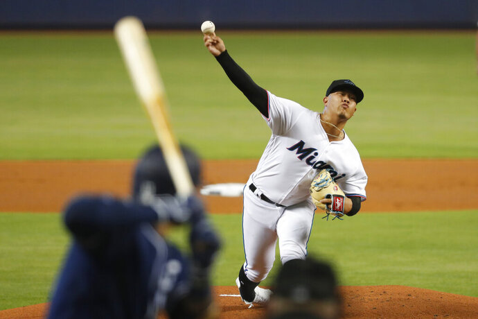 Miami Marlins' Jordan Yamamoto pitches to San Diego Padres' Manny Machado during the first inning a baseball game, Tuesday, July 16, 2019, in Miami. (AP Photo/Wilfredo Lee)