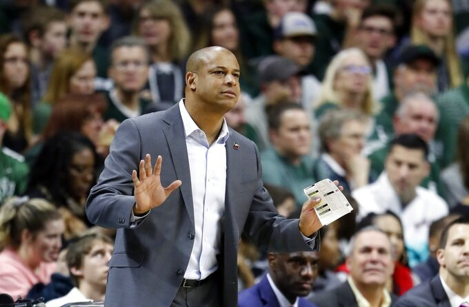 Northern Illinois head coach Mark Montgomery on the sidelines during the second half of an NCAA college basketball game against Michigan State, Saturday, Dec. 29, 2018, in East Lansing, Mich. (AP Photo/Carlos Osorio)