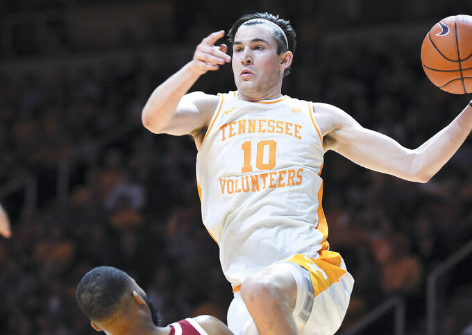 Tennessee's John Fulkerson (10) looks to pass cross court on a drive against Arkansas during an NCAA college basketball game, in Knoxville, Tenn., Tuesday, Feb. 11, 2020. (Scott Keller/The Daily Times via AP)