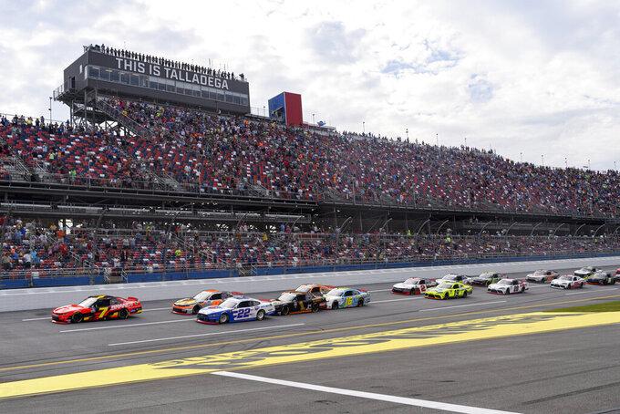 Justin Allgaier (7) leads the start of a NASCAR Xfinity Series auto race Saturday, Oct. 2, 2021, in Talladega, Ala. (AP Photo/John Amis)